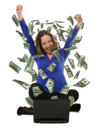 ecstatic: The woman in front of the laptop with fly out dollars. It is isolated on a white background