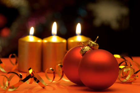 Christmas candles and red spheres. A celebratory composition Stock Photo - 10744576