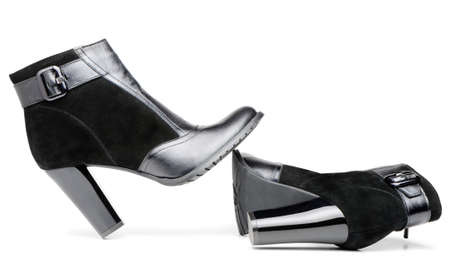 detai: Female leather boots. It is isolated on a white background