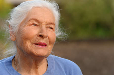 80 year old: Portrait of the elderly woman. A photo on outdoors