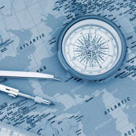 Travel objects. blue toned. Map, a ruler, a compass and divider photo