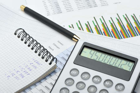 The calculator and the financial report. A workplace of the businessman Stock Photo - 11000796