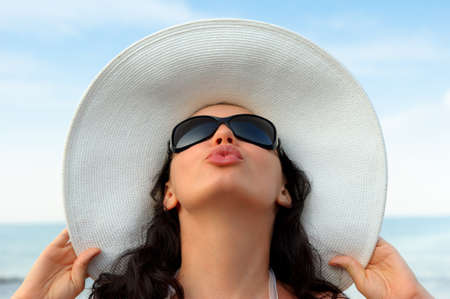 Portrait of the young woman in a hat. Seacoast, a close up Stock Photo