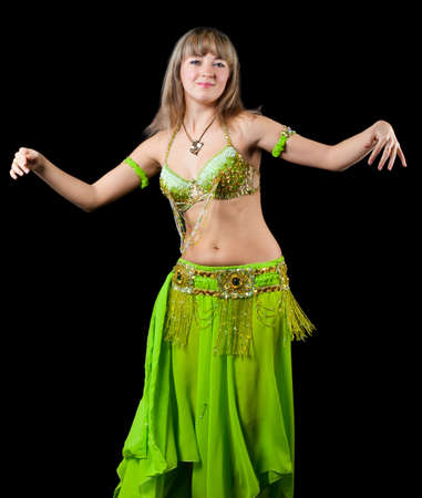 The woman in east dancing suit. Isolated on black background Stock Photo - 11010095