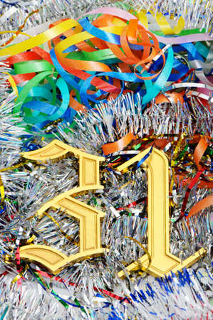 31: Gold figures 31. Figures lie on a celebratory tinsel.Concept eve of New Year Stock Photo