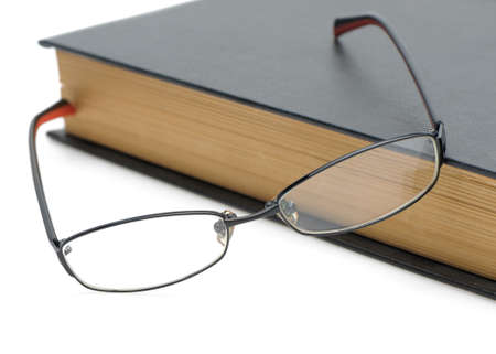 educations: Eyeglasses on the old thick book. Isolated on white background
