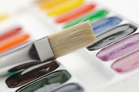 Brush with paints. Selective focus. A photo close up photo