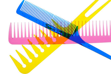 plastic comb: Set multi-coloured transparent combs. It is photographed on a gleam. It is isolated on a white background Stock Photo