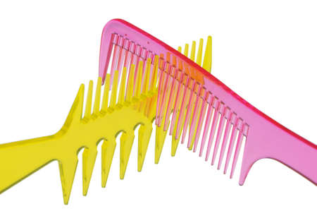 Set multi-coloured transparent combs. It is photographed on a gleam. It is isolated on a white background photo