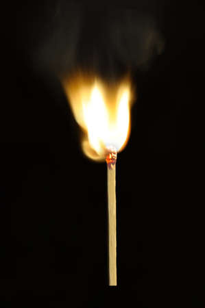 matchstick: Burning match. A photo of the moment of ignition of a match
