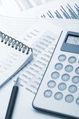 financial gains: The calculator and the financial report blue toned. A workplace of the businessman Stock Photo