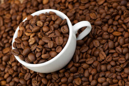 White cup with coffee grains. A photo close up photo
