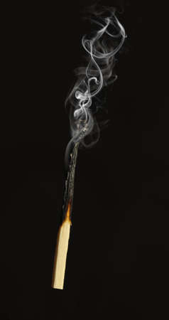 matchstick: Extinct match. A photo close up, a dark background