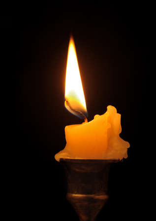 candle flame: Burning candle. An ancient candlestick, a dark background