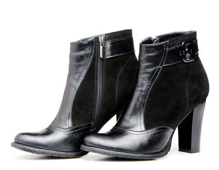 heelpiece: Female leather boots. It is isolated on a white background