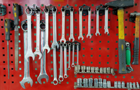 hardware repair: Set of the working tool at the stand. A workplace of the mechanic Stock Photo