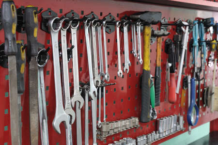 repair garage: Set of the working tool at the stand. A workplace of the mechanic Stock Photo