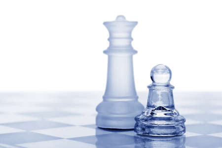 it background: Glass chess. A pawn and a queen. Blue toned. It is isolated on a white background. Stock Photo