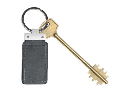 Key with leather trinket. It is isolated on a white background photo