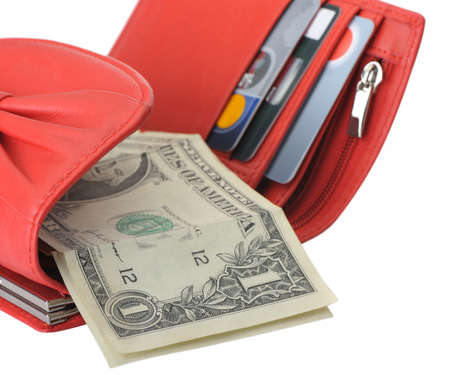 payday: Red leather wallet with dollars and credit cards. It is isolated on a white background