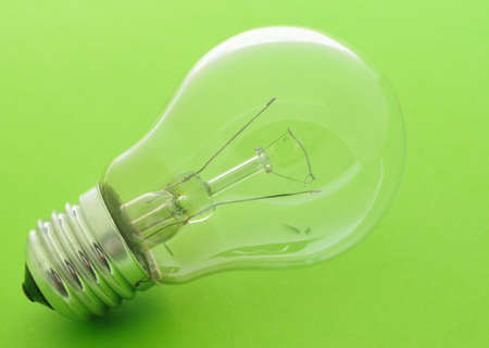 flawed: faulty a bulb. The lamp lies on a green background Stock Photo