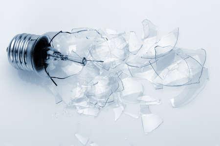 fragmented: The broken bulb. Glass splinters, blue toning