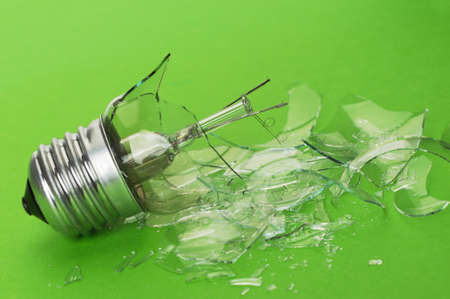 The brokenbulb. Glass splinters on a green background photo