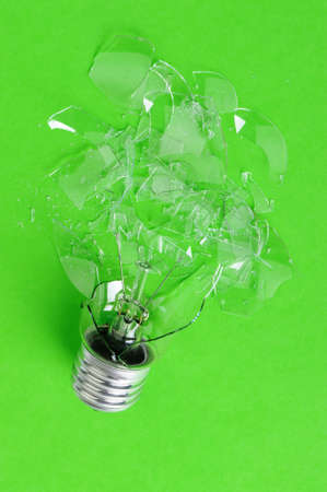 splinters: The brokenbulb. Glass splinters on a green background