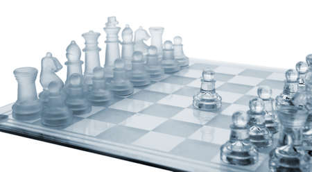 chessboard: Glass chess. The first move. Blue toned. Stock Photo