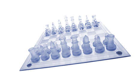 Glass chess. Blue toned. It is isolated on a white background. photo
