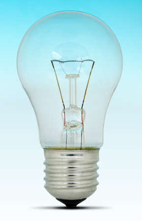 Electric bulb. It is isolated on blue - a white gradient Stock Photo - 11347265