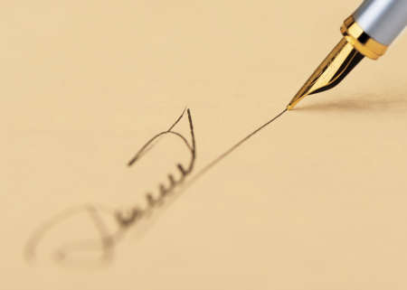 The signature close up and fountain pen.Old yellow paper. Selective focus Stock Photo - 11347330