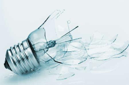 lampe: The broken bulb. Glass splinters, blue toning