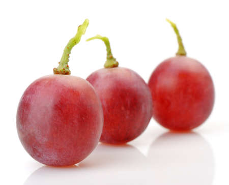 abreast: Three berries of red grapes abreast. It is isolated on a white background