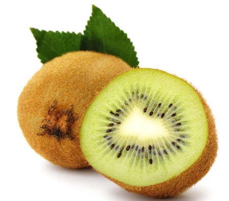 Section kiwi fruit. A detailed photo close up of exotic fruit on a white background photo