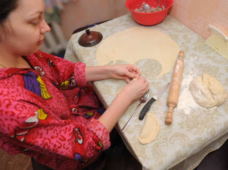 doughy: The woman prepares a pie. House conditions, cooking