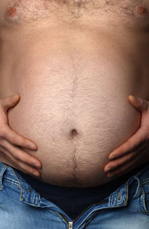 fat belly: Mans stomach close up. Concept - overweight