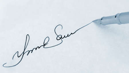 The signature close up and fountain pen. Blue toned.Selective focus photo