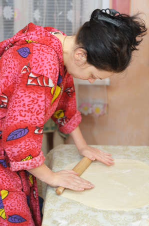 doughy: The woman prepares dough. House conditions, cooking