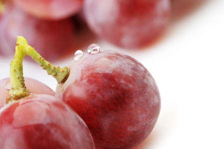 Grapes. Grapes berries in the foreground. It is isolated on a white background photo