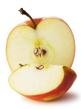 nucleo: La manzana cortada. Una foto detallada de fruta sobre un fondo blanco Foto de archivo