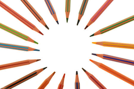 Set of plastic colour pencils located on a circle. It is isolated on a white background photo