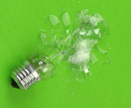 splinters: The broken bulb. Glass splinters on a green background