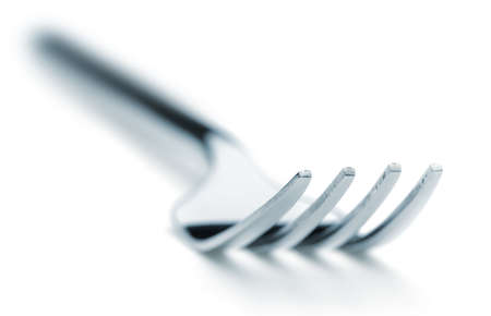 Iron fork selective focus. It is isolated on a white background photo