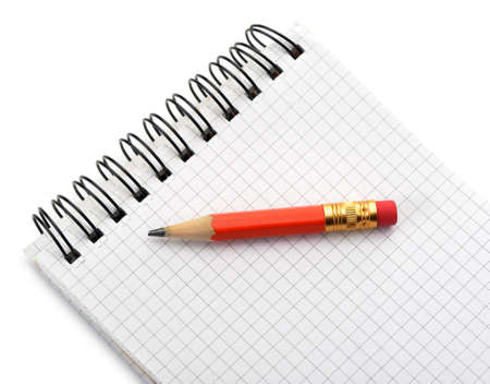 Notebook and pencil. Photo closeup. Isolated on white photo