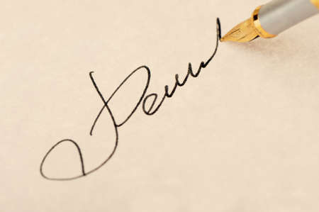The signature close up and fountain pen.Old yellow paper. Selective focus photo