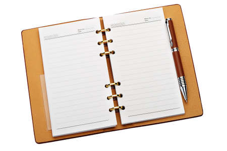 ballpoints: Open notebook with copper binding and stylish pen. It is isolated on a white background