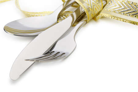 silver cutlery: Spoon, fork and a knife tied up celebratory ribbon. It is isolated on a white background Stock Photo