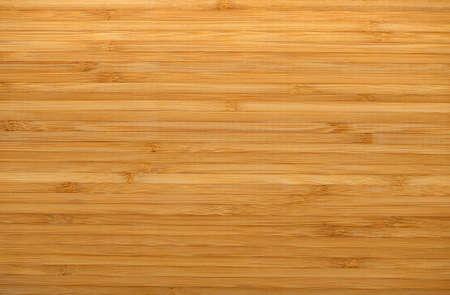 horizontal lines: Textura de madera. Una foto detallada de una estructura de bamb� prensado Foto de archivo