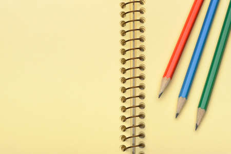 Notebook yellow paper and set pencil. Photo closeup photo